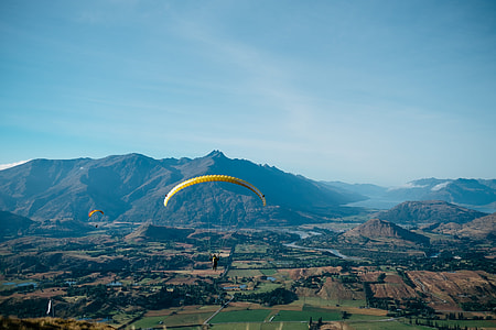 man doing paragliding during daytime