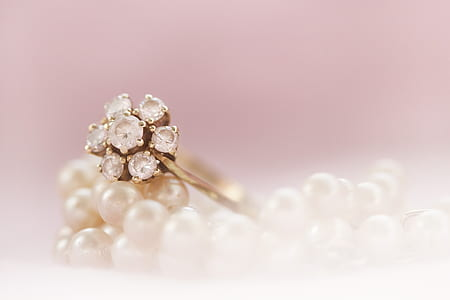 silver-colored clear gemstone encrusted flower ring