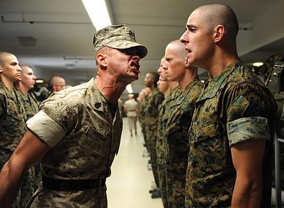men wearing military uniform standing inside building