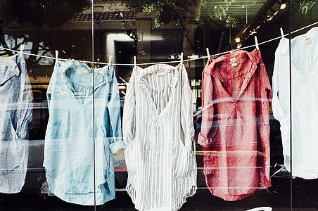 five assorted-style shirts hanged
