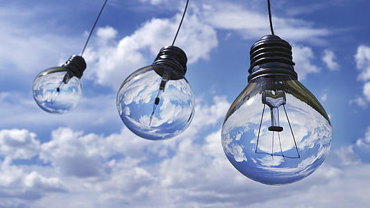 three clear glass light bulbs