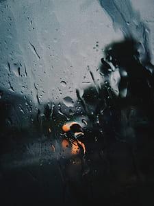 Shallow Focus Photography of Rain on the Window