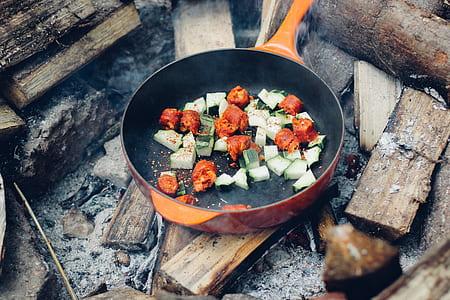 sliced veggies on non-stick pan