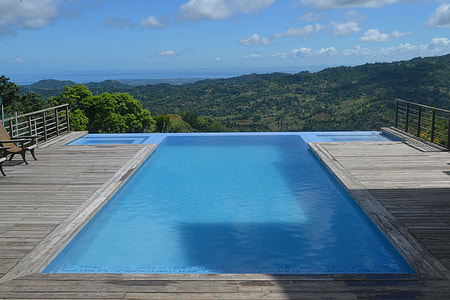 blue and gray pool over looking the mountain ranges