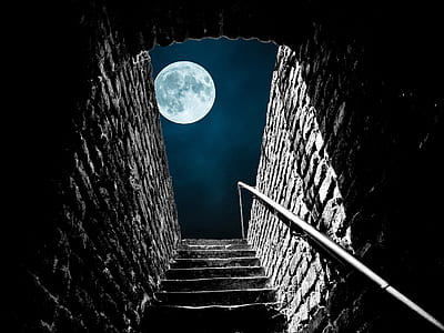 gray concrete stairs under full moon during nighttime