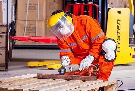 man holding brown angle grinder
