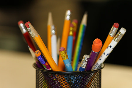 assorted-color pencil on pen organizer