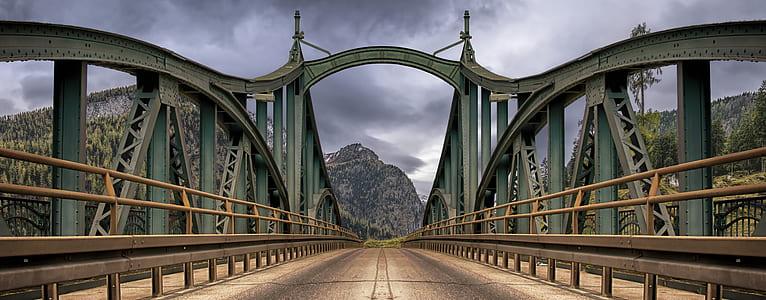 grey concrete bridge near mountains