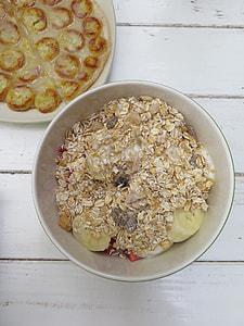 oat meal in white ceramic bowl and slice banana