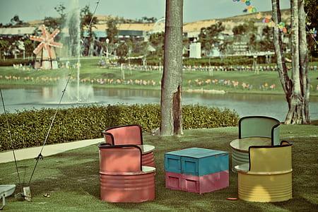 multicolored barrel patio set near a lake photo