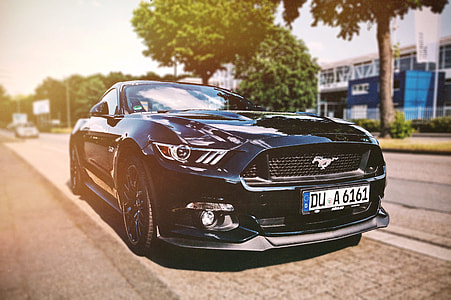 photography of black Ford Mustang GT