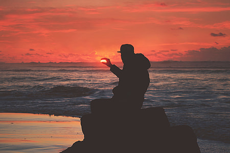 Silhouette of a man on the coast at sunset