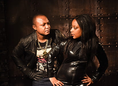 2 Persons Wearing Black Leather Jacket