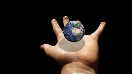 globe in human hand clip-art