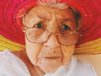woman wearing red and yellow woven hat