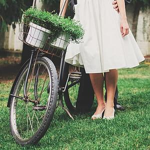 woman standing beside bike