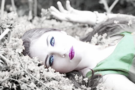 woman lying on flower bed