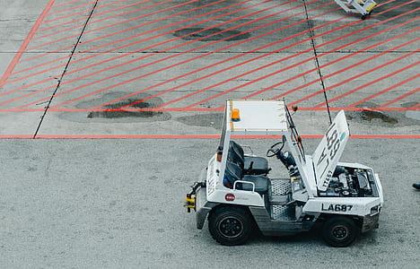 White Black La687 Mini Toy Car on Parking Lot