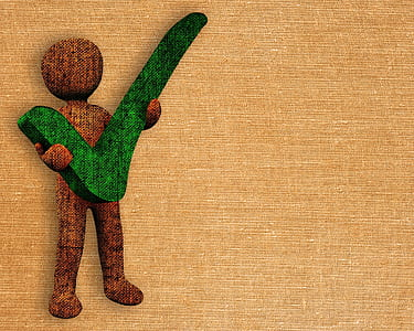 man carrying green check artwork