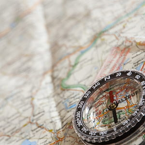 round black compass on map