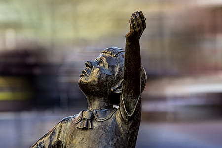 selective focus photo of boy statue during daytime