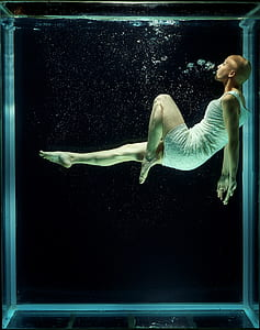 person floating in water