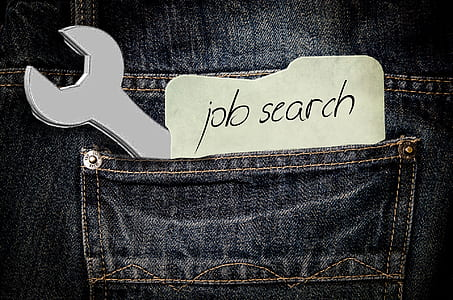 wrench on pocket with job search text overlay