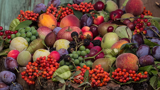 pile or peaches, apples, berries and passion fruits