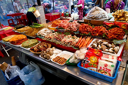 assorted street food lot on stainless steel table