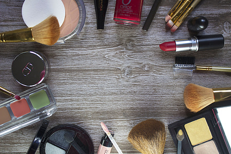 lot of assorted cosmetics on table