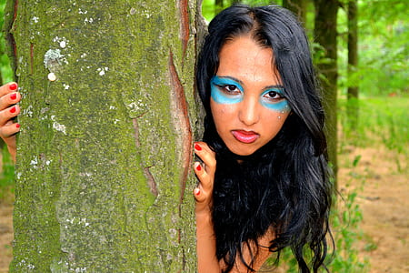 woman in blue face paint during daytime