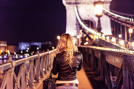 Blonde Girl Walking on Chain Bridge in Budapest