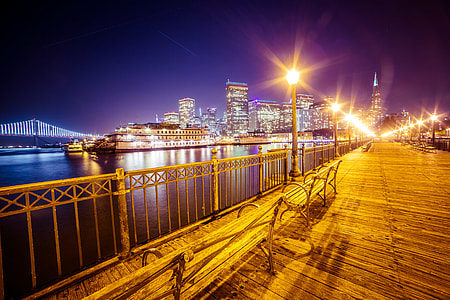 Old Pier and San Francisco Skyline with Bay Bridge at Night
