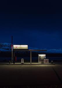 turned-on lights on gas station