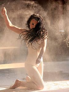 woman in white bodysuit