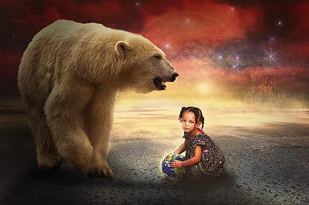 girl playing ball beside polar bear