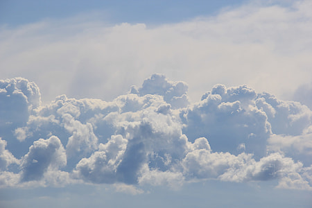 white cumulus clouds during daytime