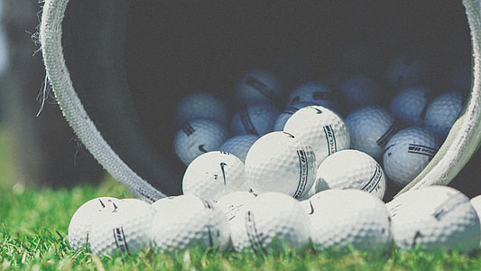 selective focus photograph of golf balls