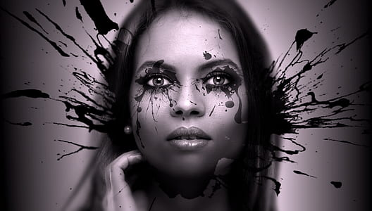 woman's face with black ink