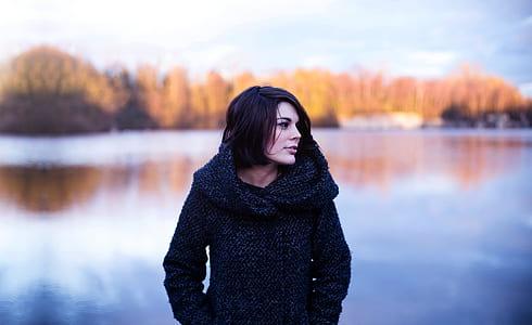 woman wearing black hoodie selected focus photography