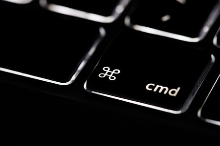 Macro shot of the command key on the backlit keyboard of a laptop computer. Image captured with a Canon 6D