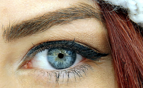 closeup photo of woman's left eye
