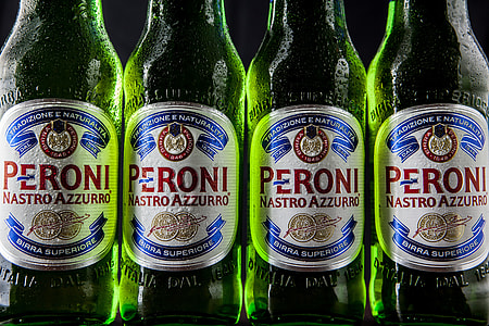 Close-up shot of green Peroni lager beer bottles
