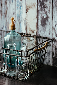 Collection of bottles in metal mesh basket