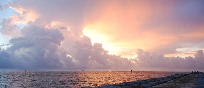 golden hour photography of sea shore