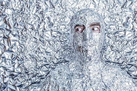 person covered with foil