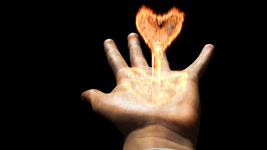 left hand with heart-shape flame