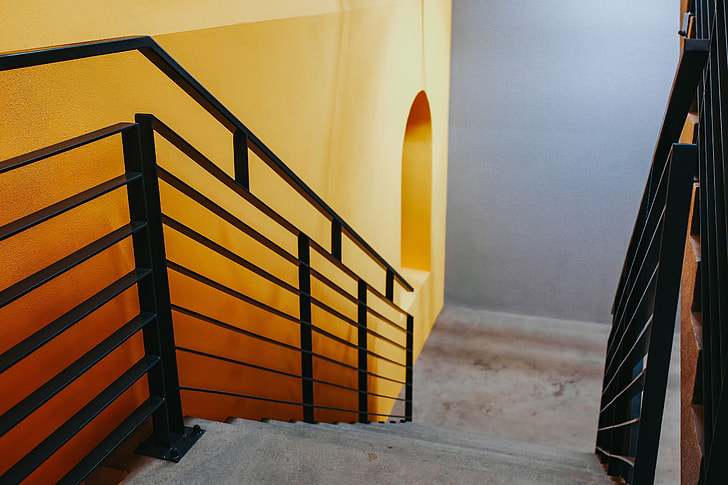 Royalty-Free photo: Staircase by a yellow wall | PickPik