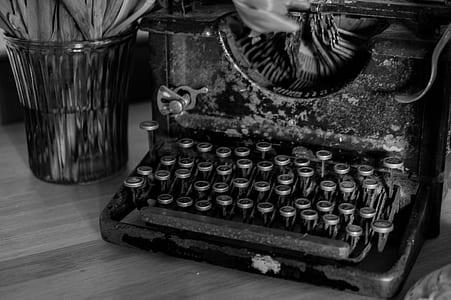 grayscale photo of vintage black typewriter