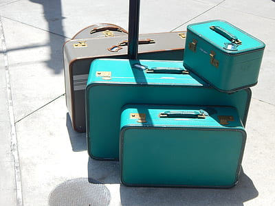 three teal and two gray suit case set